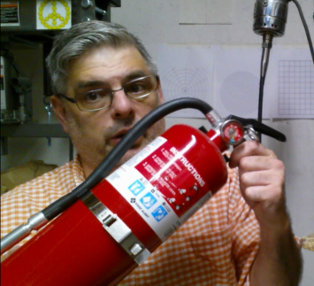 Keep a Fire Extinguisher by the door of your shop or work space, not near your bench.